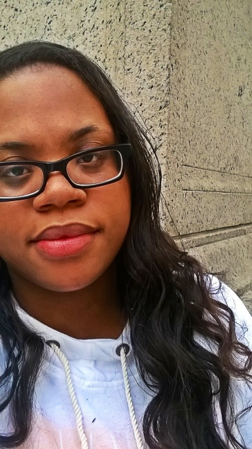 Sanaa Brooks sitting on NYPL steps after Real Simple Magazine's Beauty and Balance Event