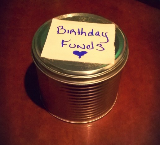 Sanaa Brooks saving money in a tin can idea